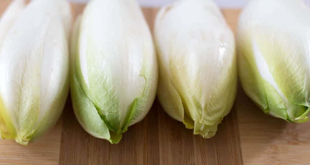 Belgian endive are a delicious vegetable, raw or cooked. In this simple recipe, they are basted with vinaigrette and grilled.