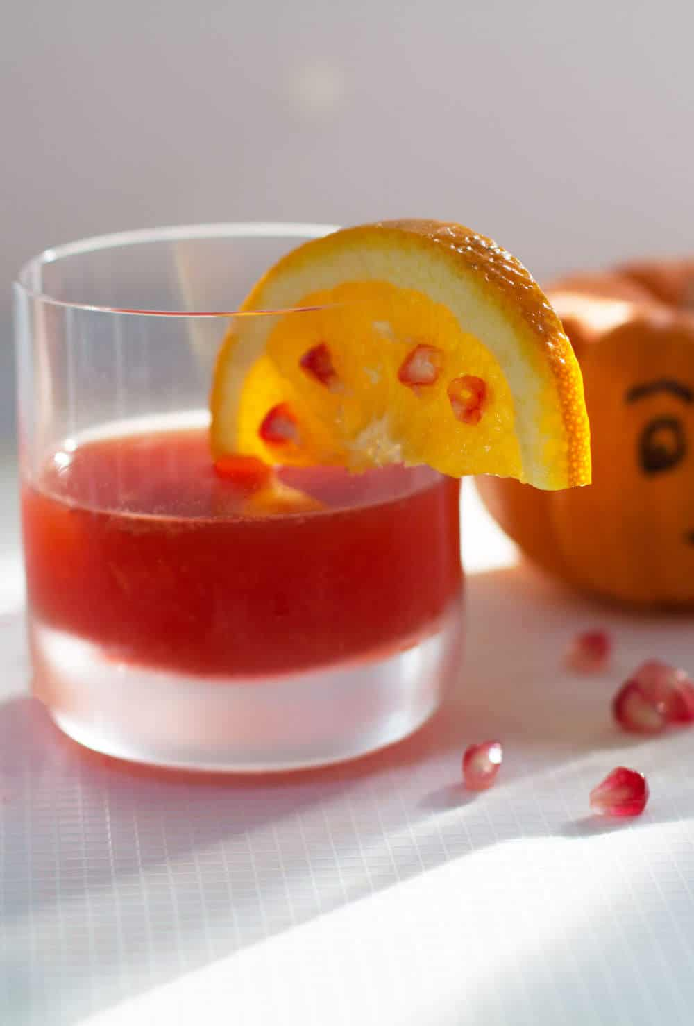 Halloween Pomegranate Negroni, a new take on a delightful and classic cocktail. | Mother Would Know