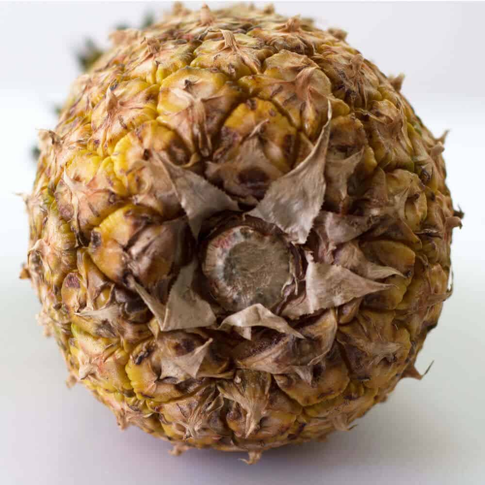 The stem or base of a pineapple is a good place to look for indications that the pineapple is ripe or overripe.