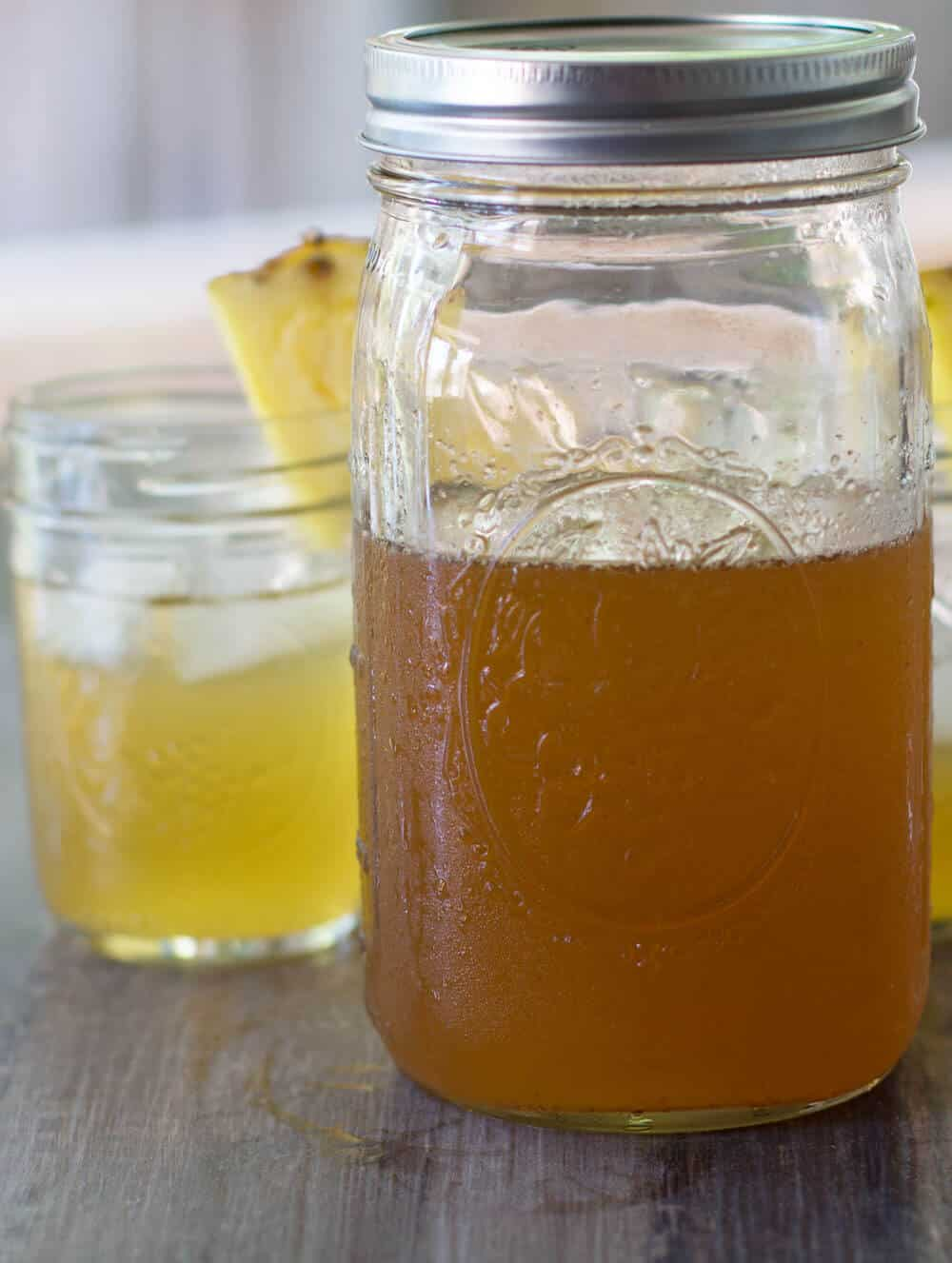 Spiced pineapple shrub ready to enjoy - just mix with club soda or seltzer. | Mother Would Know
