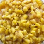 Pineapple pieces and sugars after steeping overnight in refrigerator for spiced pineapple shrub.