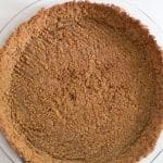 Graham cracker pie crust baked and ready to be filled.