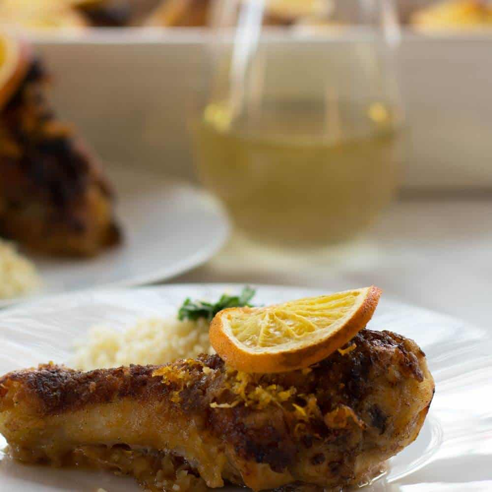 A piece of Fragrant Baked Orange Rosemary Chicken, ready to eat. | Mother Would Know