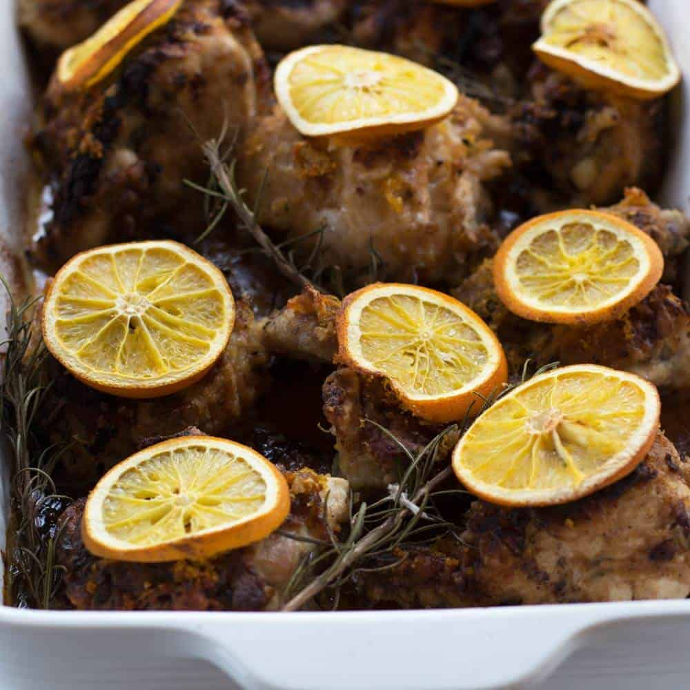 chicken topped with citrus in a white casserole