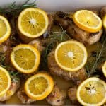 A casserole of Fragrant Baked Orange Rosemary Chicken ready to bake.