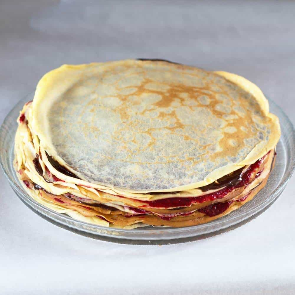 crepe cake filled with berry sauce and ganache, undecorated
