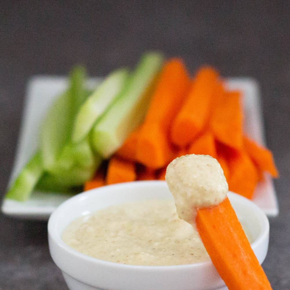 Healthy Yogurt Curry Dip with a carrot