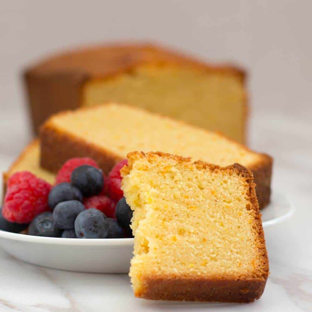 Passover orange-scented loaf cake with fruit on a plate
