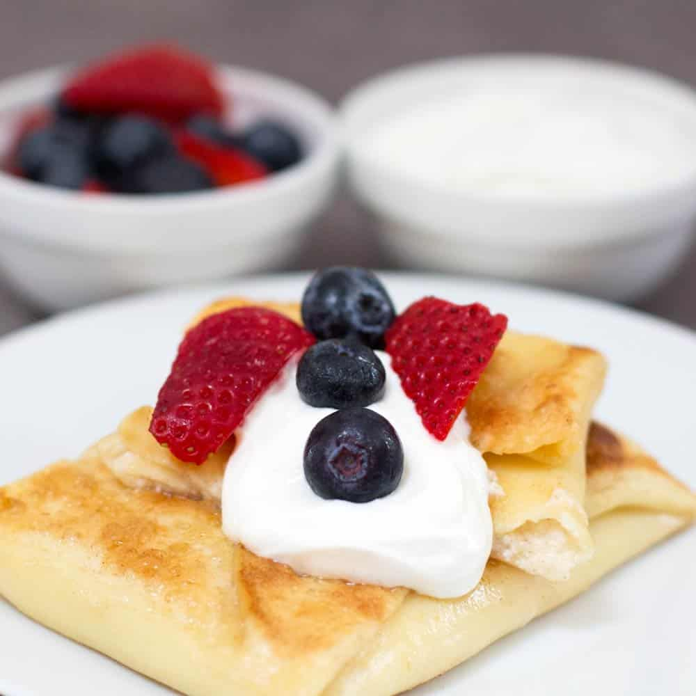 Jewish cheese blintzes for Shavuot with fruit and sour cream