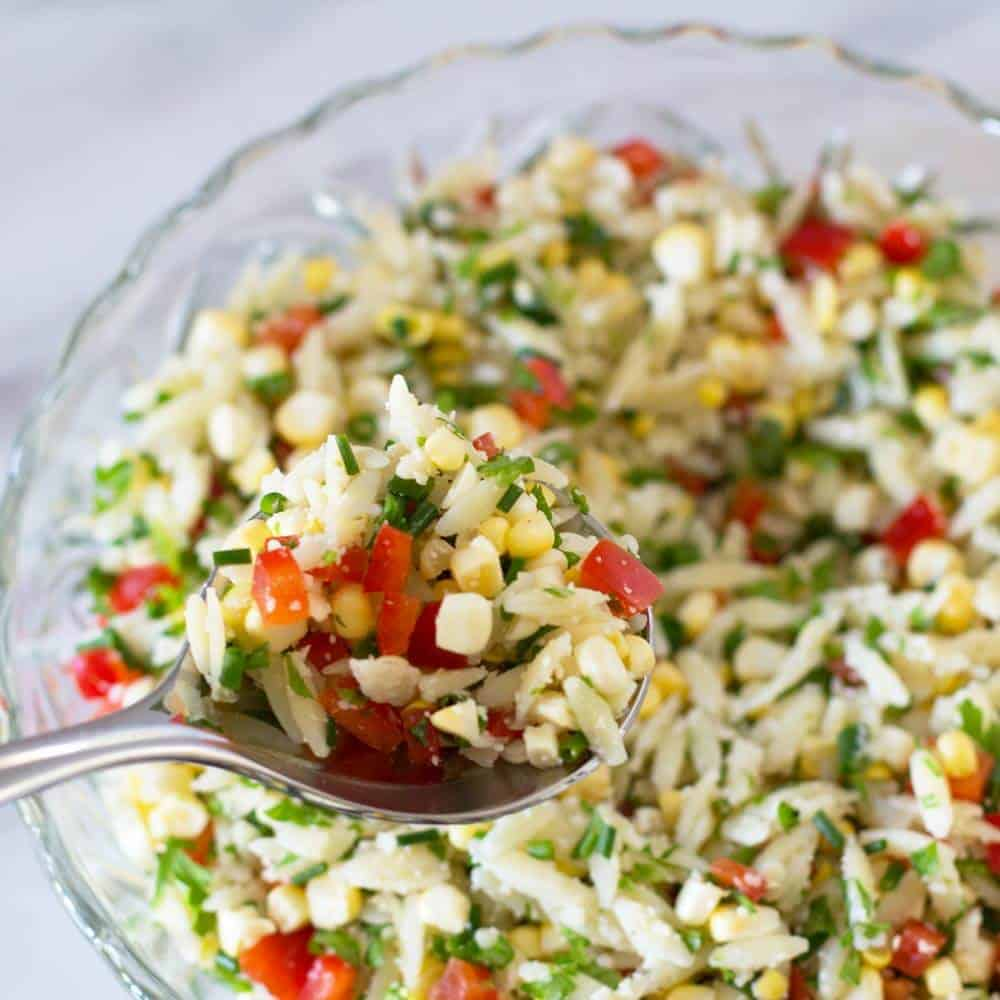 Colorful Crunchy Orzo Vegetable Salad done in bowl with spoon