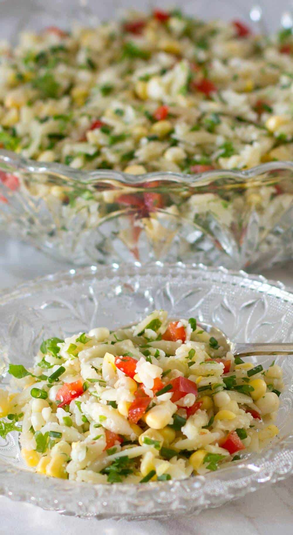 Crunchy colorful orzo salad, ready to eat.
