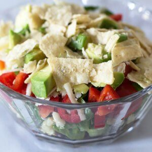 Make-Ahead Layered Southwestern Salad in glass bowl. | Mother Would Know