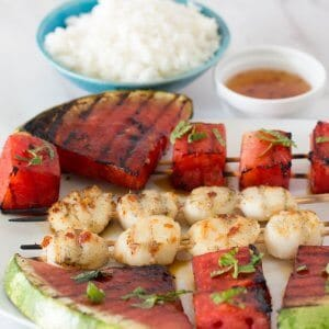 Grilled Watermelon Scallop Shish Kebobs with rice and extra sauce.