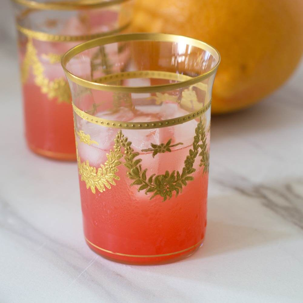 Campari grapefruit punch on the rocks with seltzer