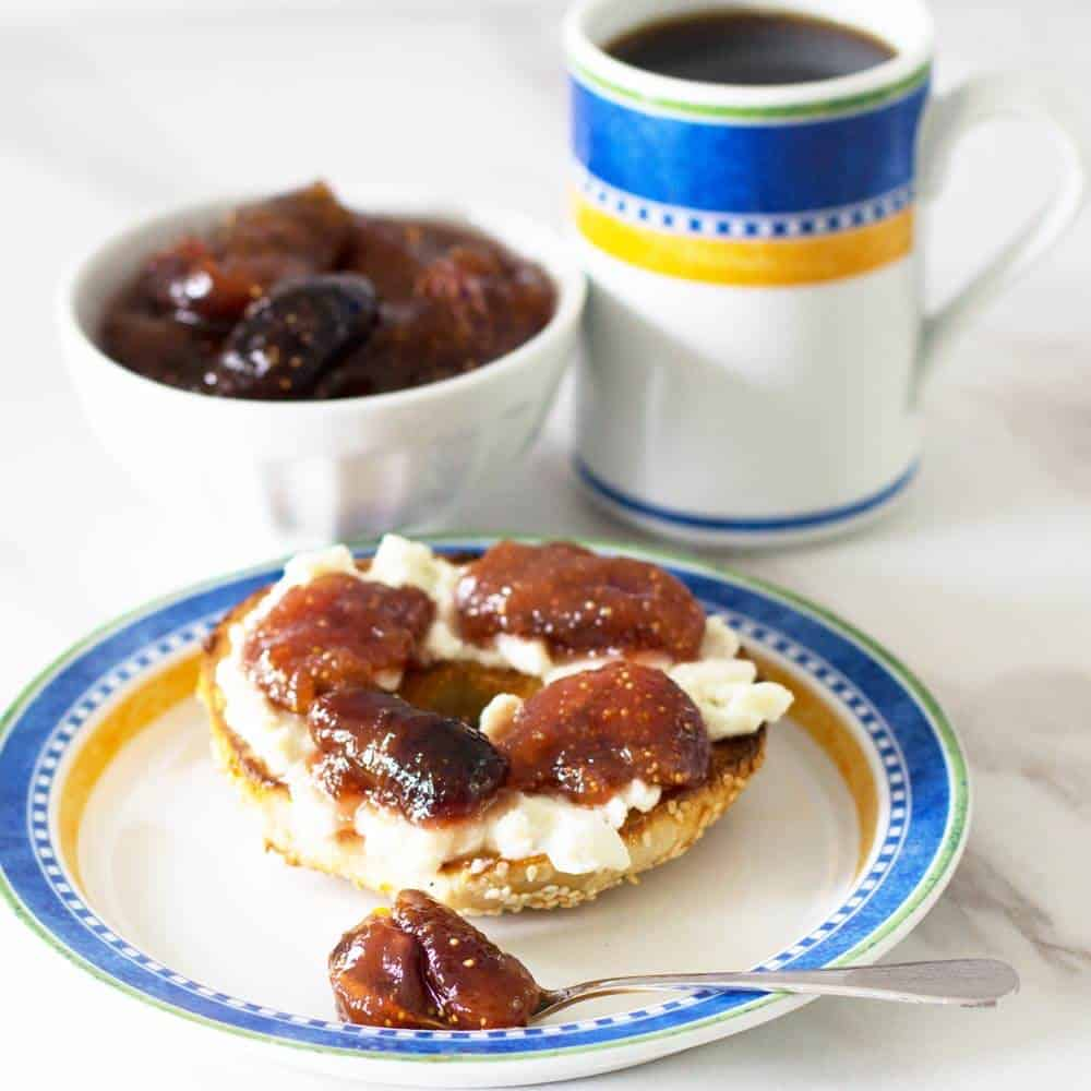 Fresh fig compote on a bagel with coffee