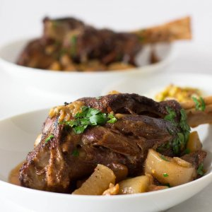 Indian-style keto lamb shanks in two bowls, with vegetables