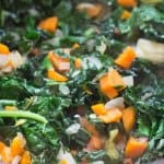 wilting kale for Tuscan Farro Bean Soup