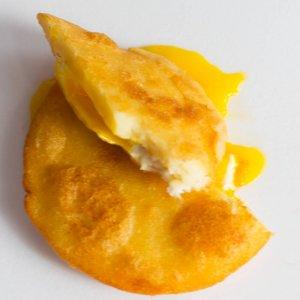 arepa de huevo or fried corn cake with egg, opened