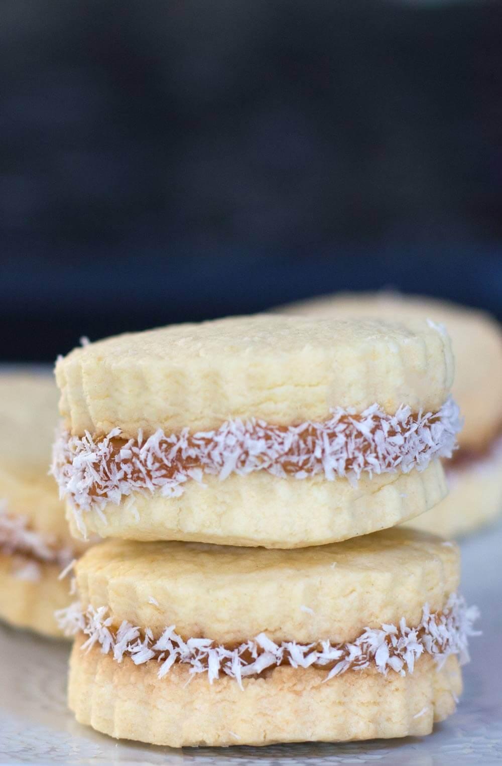 a pile of alfajores or dulce de leche sandwich cookies