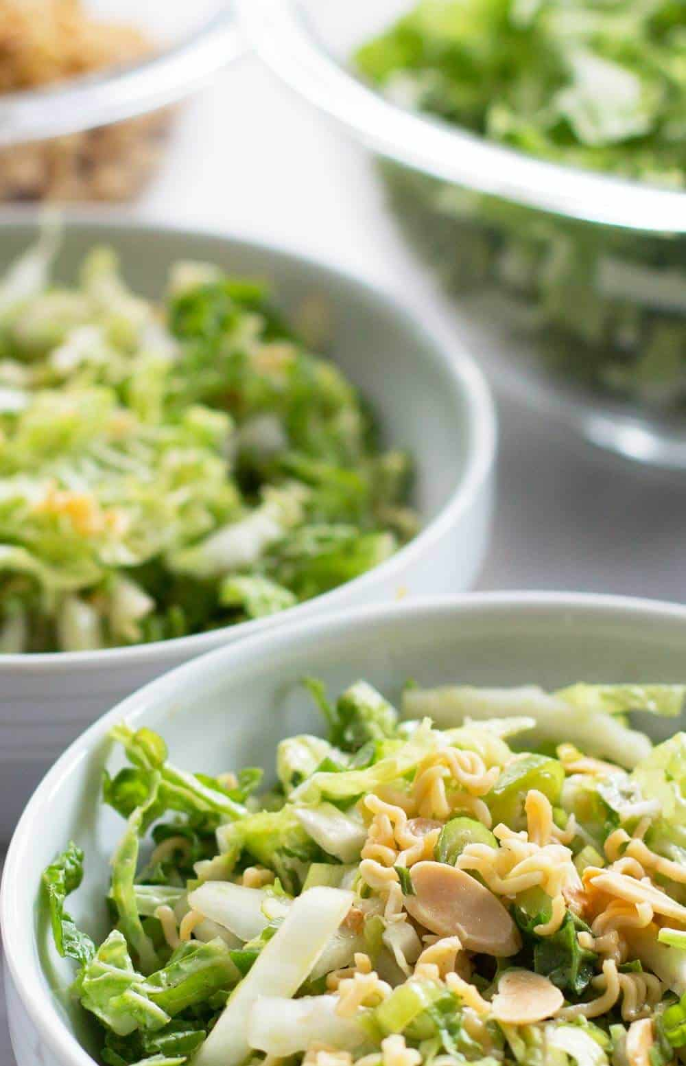 crunchy Napa cabbage salad with a bowl of cabbage behind
