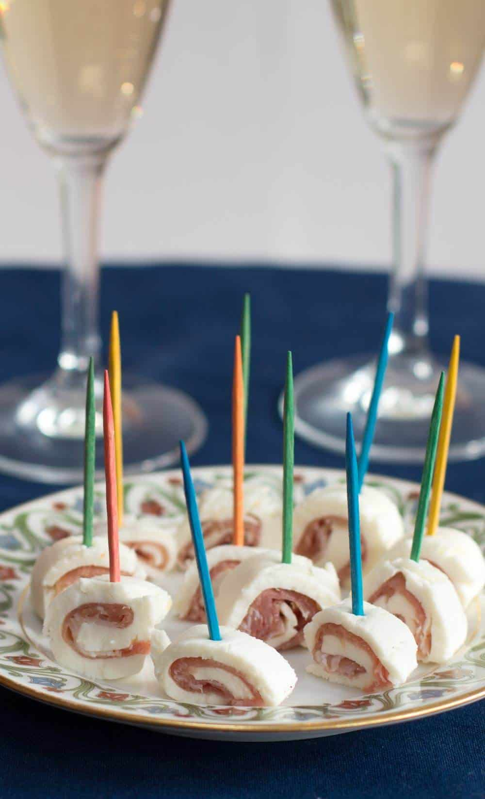 Fancy Prosciutto and Mozzarella Appetizers ready for a party, with champagne flutes.