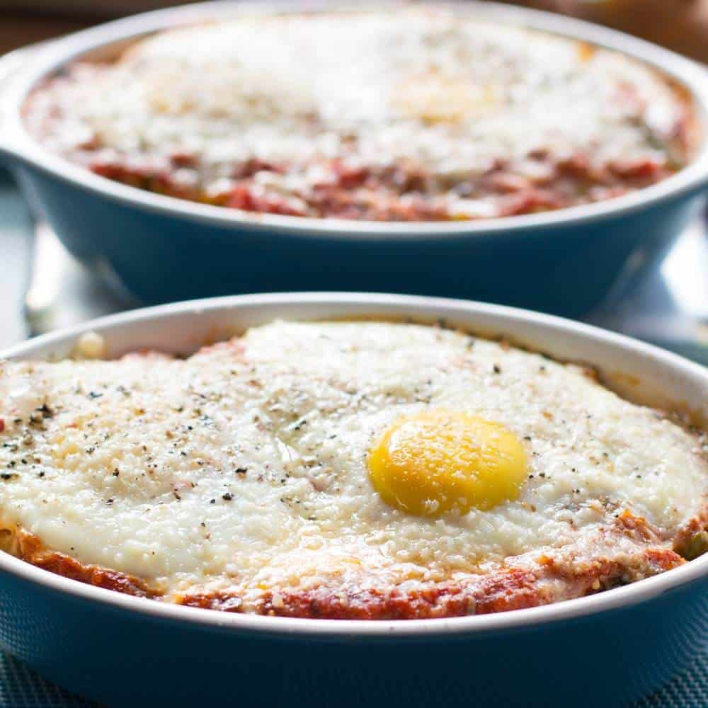 Tuscan baked eggs with vegetables in a baking dish.