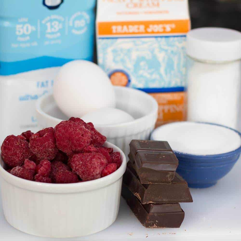 The ingredients for chocolate raspberry pots de creme.