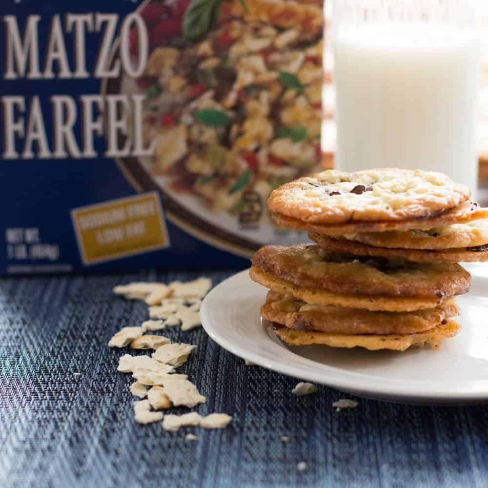 Matzo farfel and box beside a stack of Passover florentine chocolate cookies