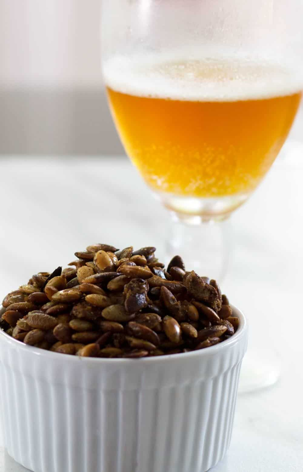 Pepitas in a ramekin with beer