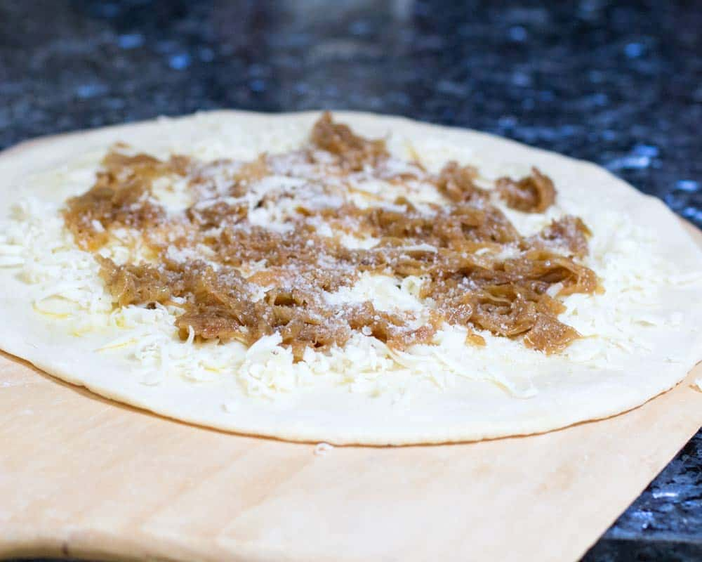 caramelized onion white pizza ready to go into the oven