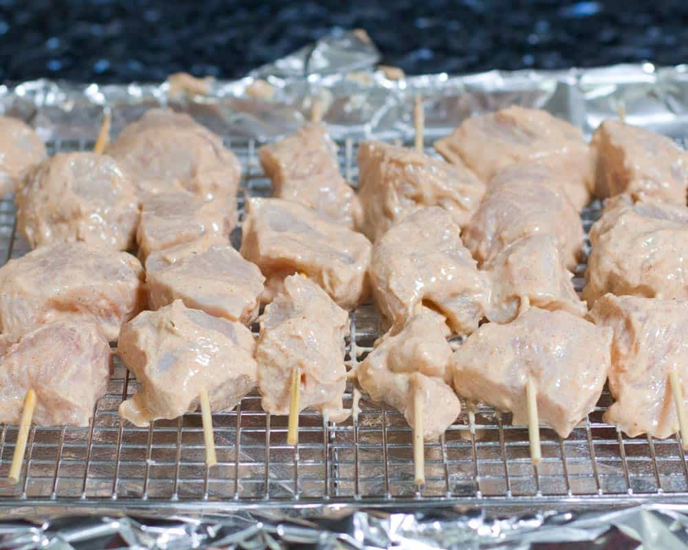 uncooked chicken ready to go in the oven or on the grill for kathi rolls