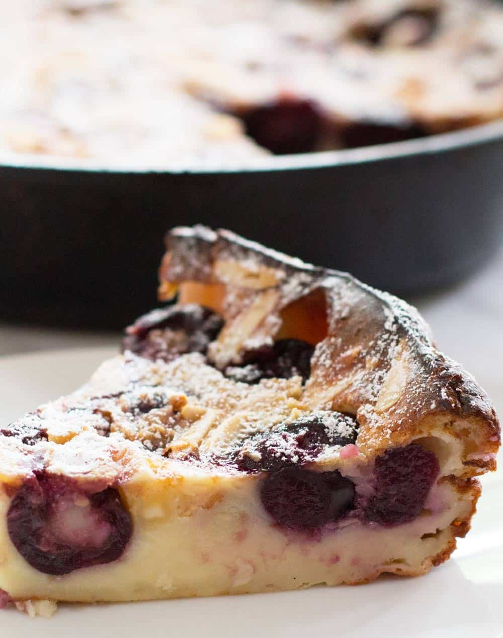 piece of cherry clafoutis on a plate
