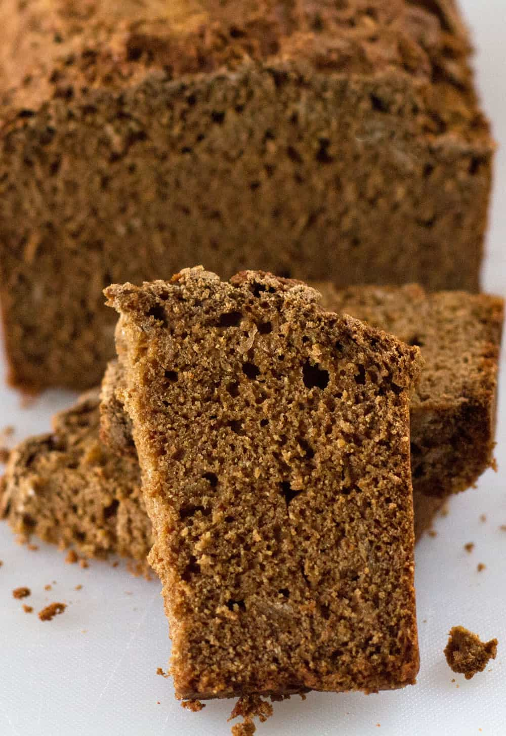A slice of Irish brown bread with the loaf in the background