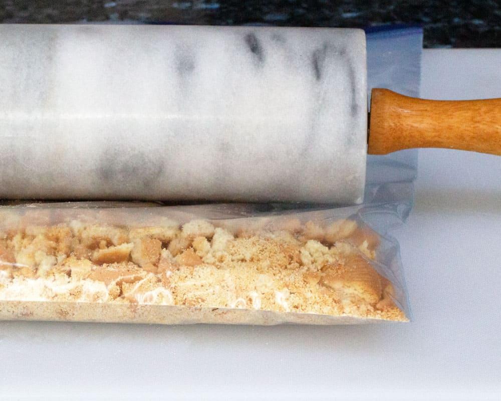 crushing biscuits for base of no-bake lemon mascarpone cheesecake