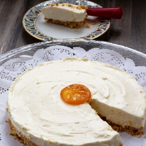 mo-bake lemon mascarpone cheesecake with a slice cut out