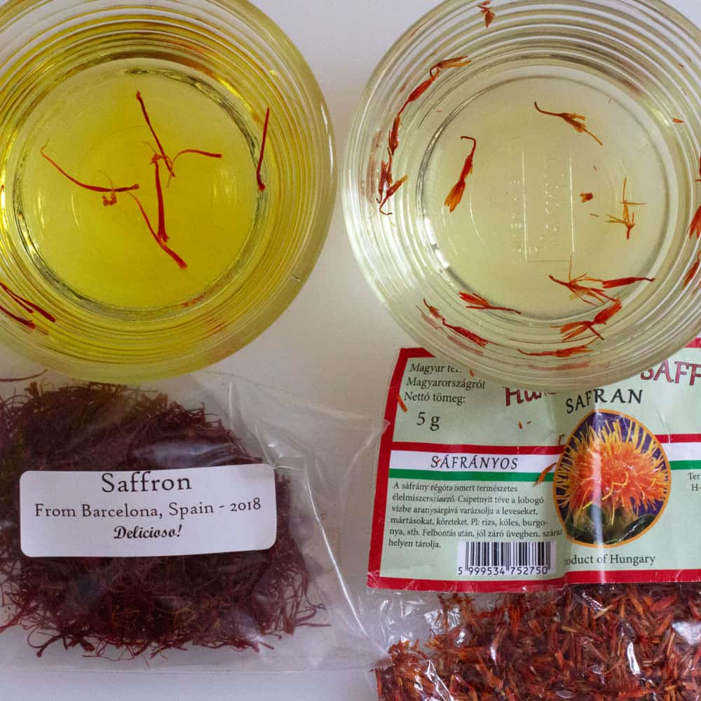 real and fake saffron, side-by-side in water