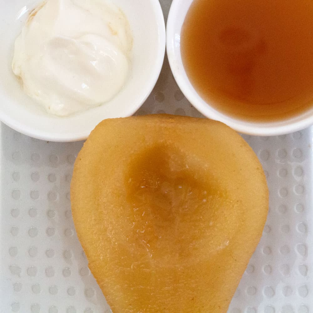 poached pear with sweetened yogurt and sauce