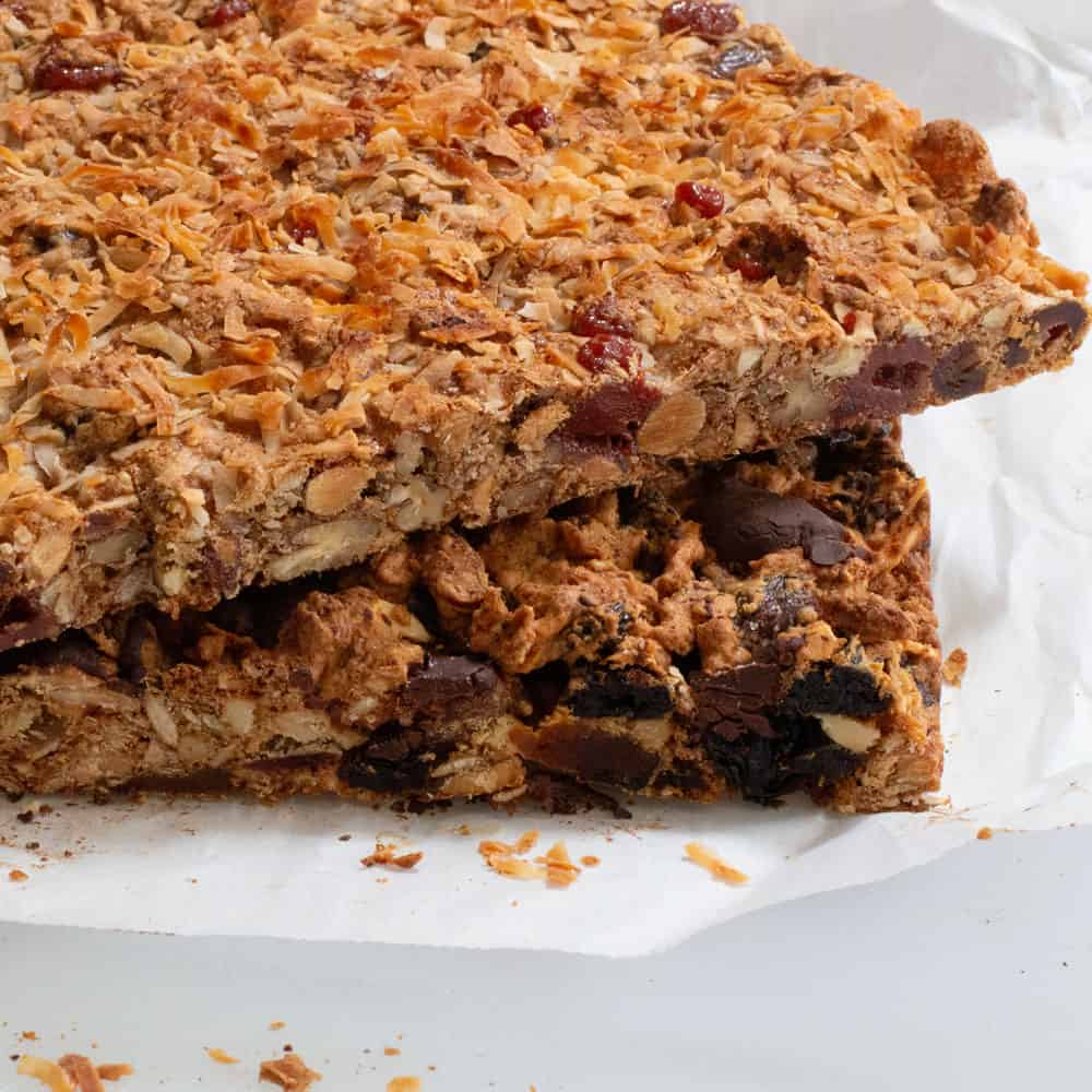 2 batches of dried fruit & nut bars stacked at an angle
