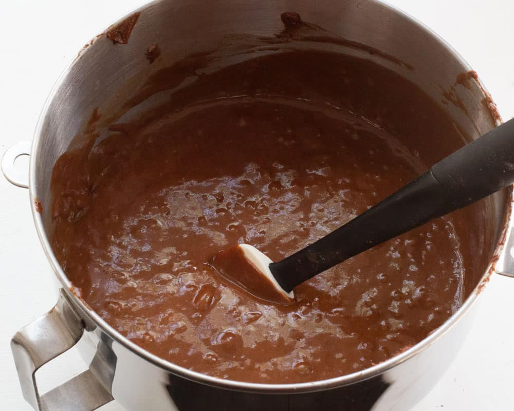 loosening the batter of the chocolate yogurt cake with boiling water