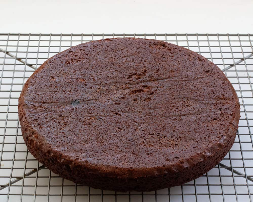A layer of chocolate yogurt cake, out of the pan, and cooling