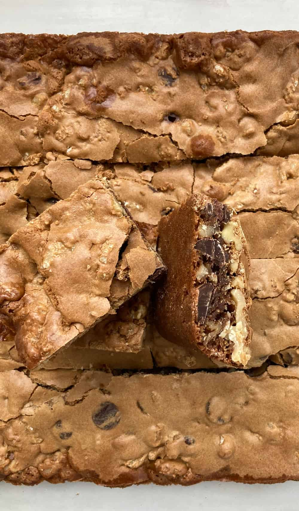 pan of walnut chocolate chip blondies with two squares on top
