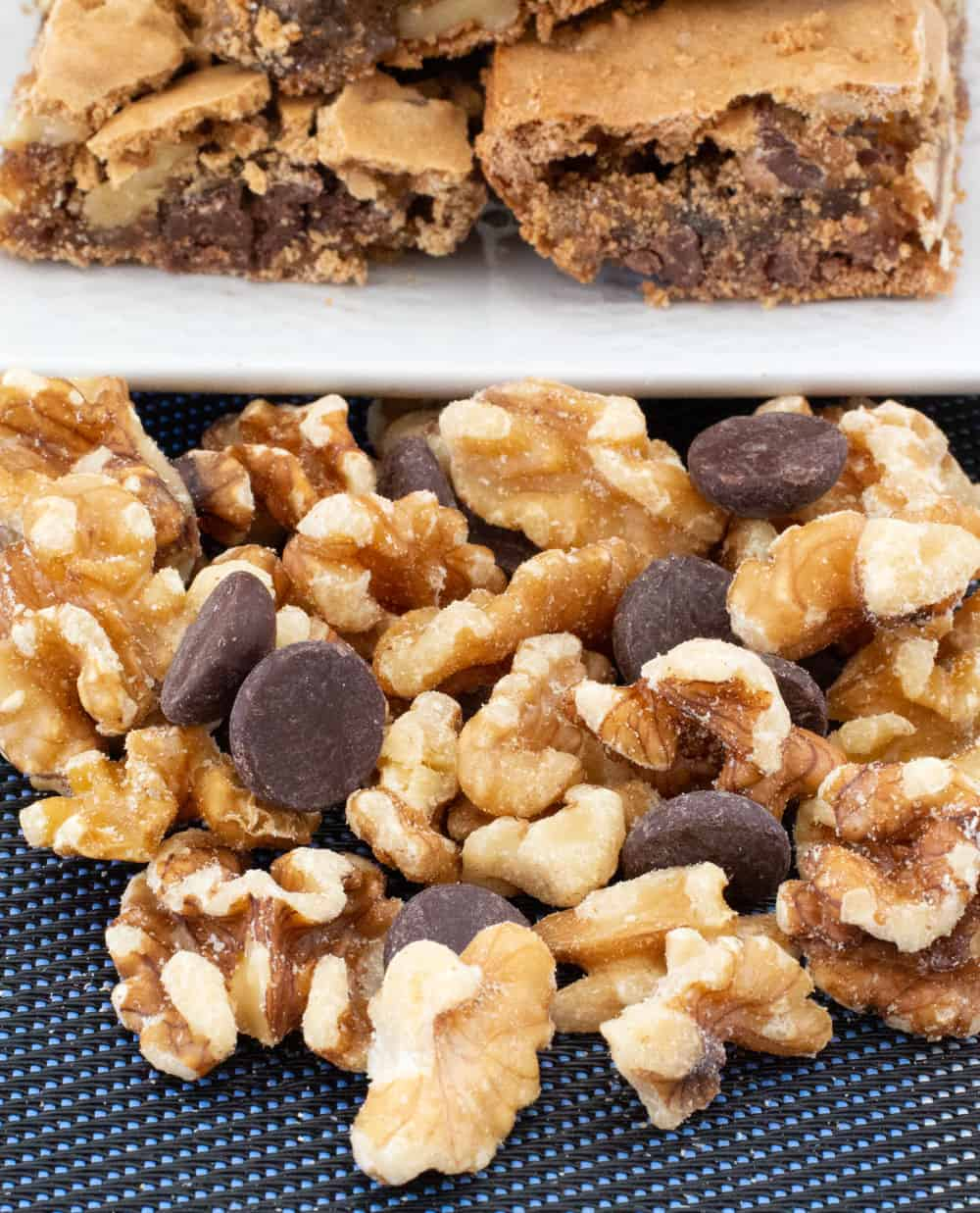 walnuts and chips in front of walnut chocolate chip blondies