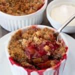 spoonful of granola streusel crisp on baked fruit