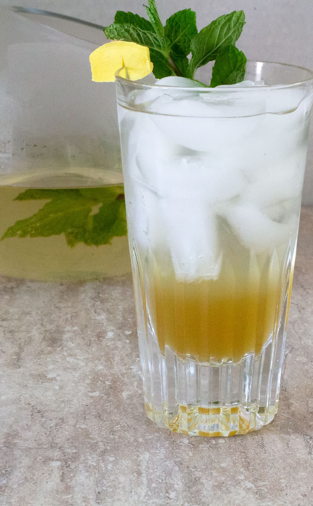 a glass of ginger mint agave soda