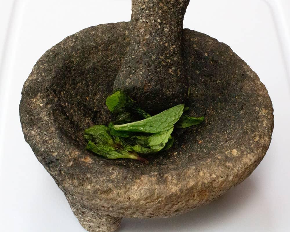 muddling mint for ginger mint agave soda