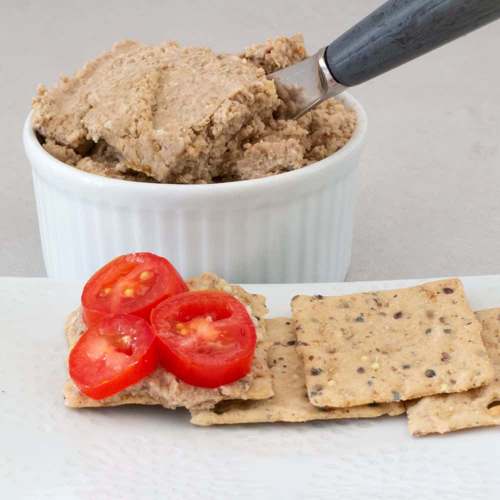 vegetarian chopped liver with lentils on a cracker and in ramekin