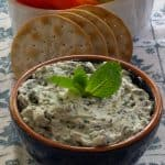 Mint Basil Ricotta Dip with crackers and cut up vegetables