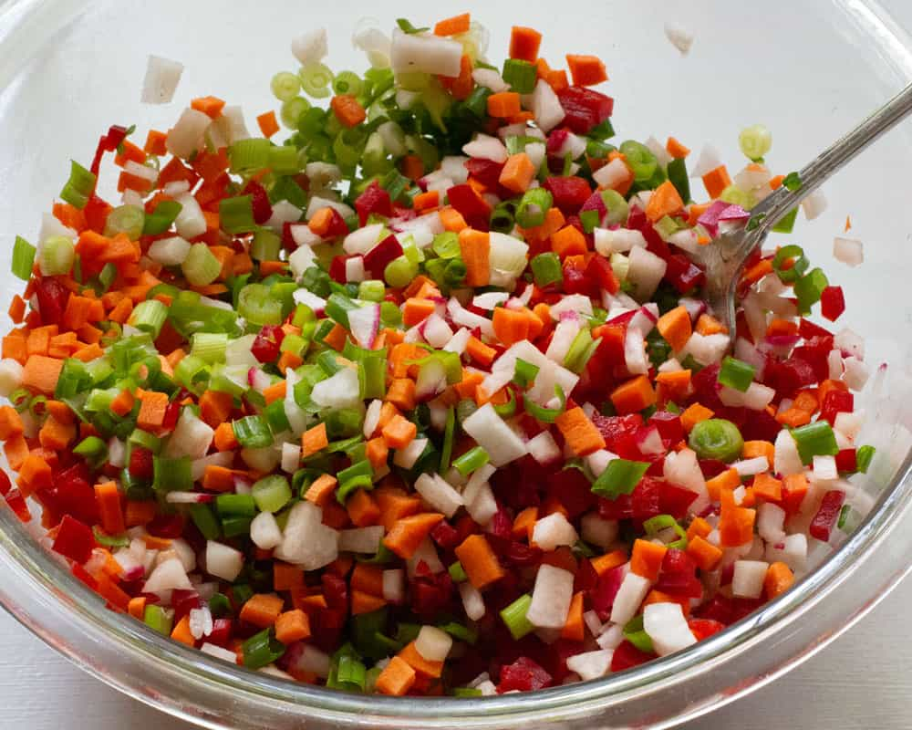 a bowl of mixed, chopped vegetables