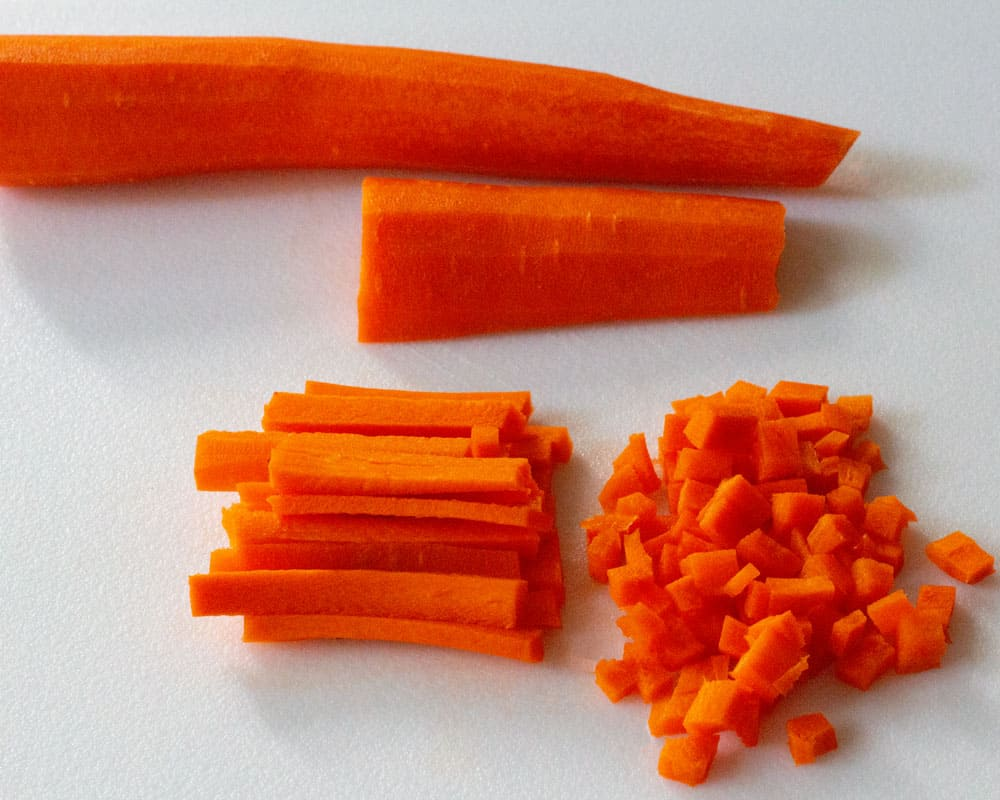 chopping carrots for rice salad