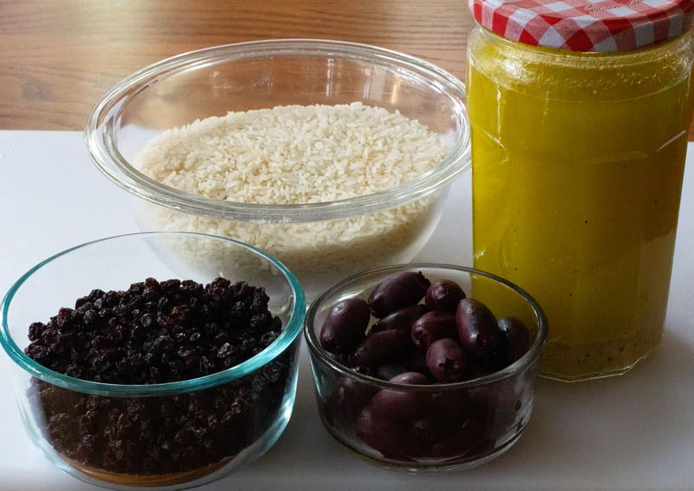 rice, dressing, currants and olives for confetti rice vegetable salad